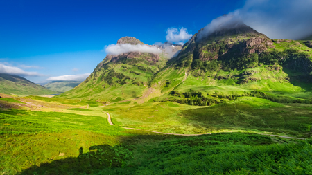 Beautiful sunrise and tiny shadow of man, Glencoe, Scotland