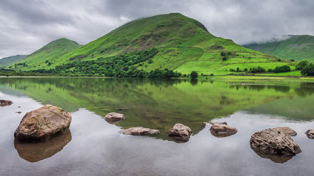Lake and green hills in District Lake, England Фото со стока