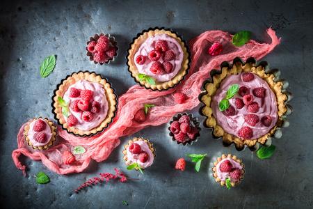 Homemade tarts with fresh raspberries and mascarpone