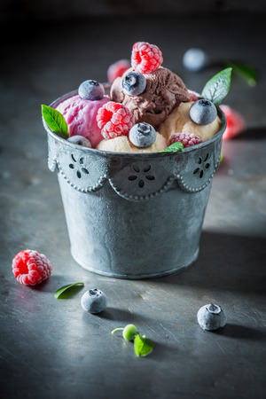 Cold ice cream with fresh blueberries and raspberries