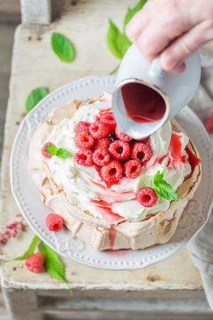 Top view of Pavlova cake made of mascarpone and berries