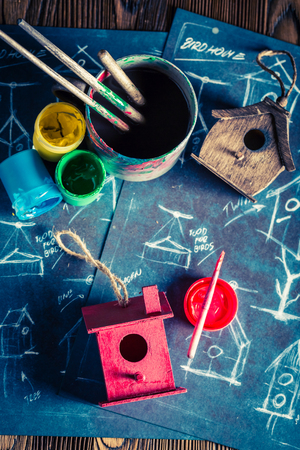 Top view of homemade small bird house and project drawing on blackboard Stock Photo - 103187179