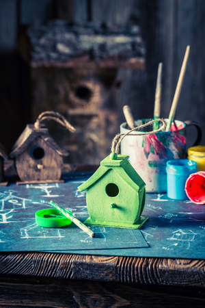 Closeup of handmade home for birds in wooden workshop Stock Photo