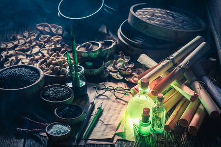Magical scrolls and recipe in old kitchen laboratory Stock Photo