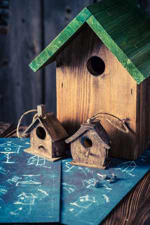 Closeup of cute home for birds in wooden workshop