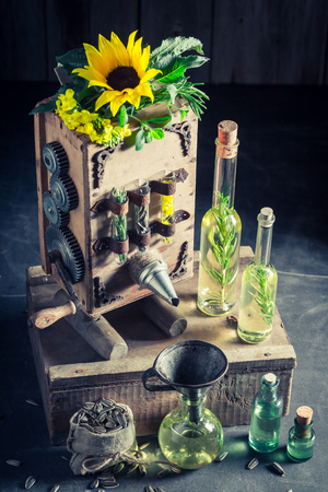 Extraordinary virgin oil machine with seeds and sunflower
