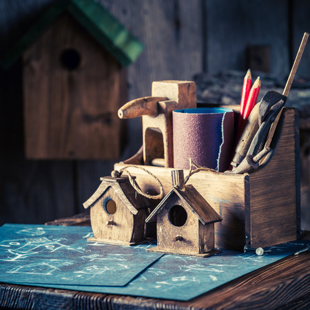 Handmade small bird house and blue construction plan 写真素材