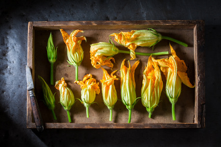 Ingredients for tasty roasted zucchini flower in wooden box Zdjęcie Seryjne