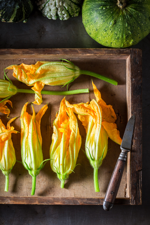 Preparation for crispy roasted zucchini flower in wooden box