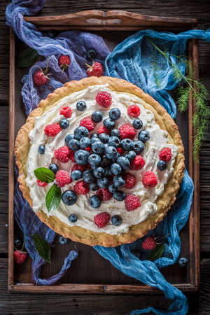 Top view of sweet tart made of berries and mascarpone Stock Photo