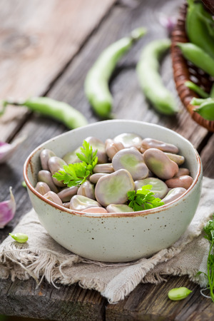 Closeup of broad beans on old wooden table Stok Fotoğraf