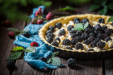 Homemade and sweet tart with blackberries and caster cugar