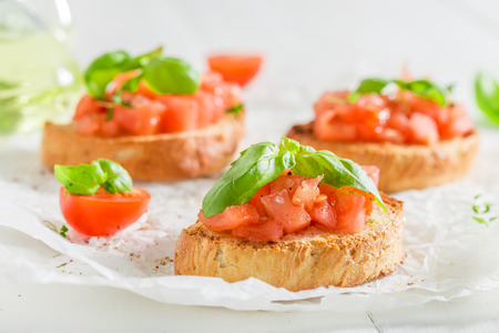 Closeup of homemade bruschetta with tomato and basil