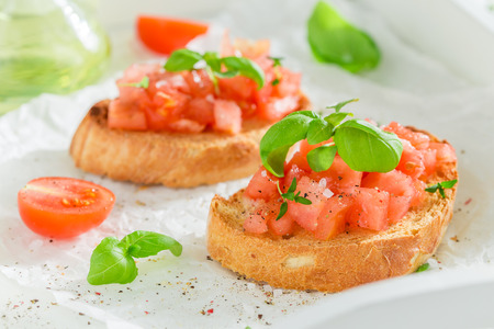 Fresh and tasty bruschetta with basil and tomato