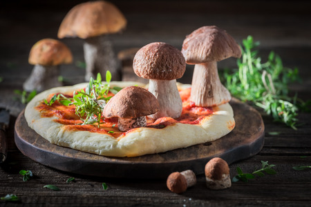 Homemade and rustic pizza with wild mushrooms and herbs Stock fotó
