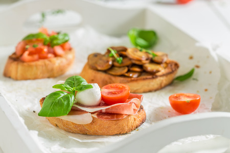 Various bruschetta with fresh ingredients for breakfast