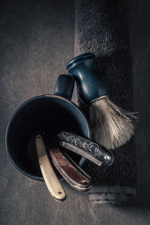 Antique tools for shave with grey soap, razor and brush