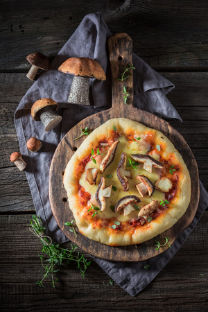 Homemade pizza with herbs and wild mushrooms Stock fotó
