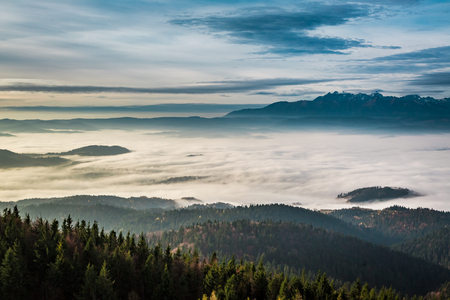 Foggy and cold sunrise in the Tatra Mountains in autumn Stock Photo