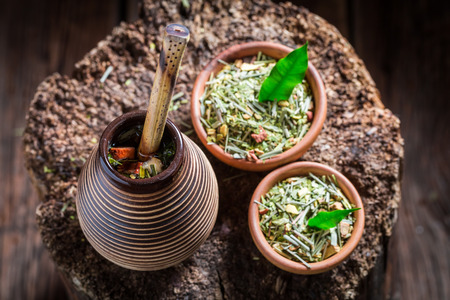 Top view of flavor yerba mate made of dried leaves