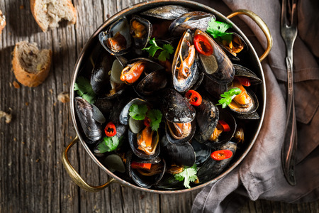 Closeup of delicious and spicy mussels with garlic and coriander Stock fotó