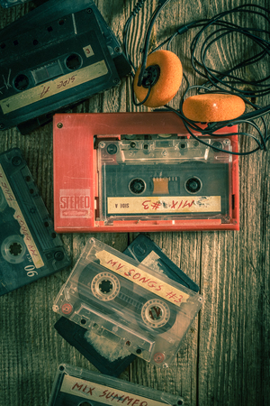 Vintage audio cassette with walkman and headphones