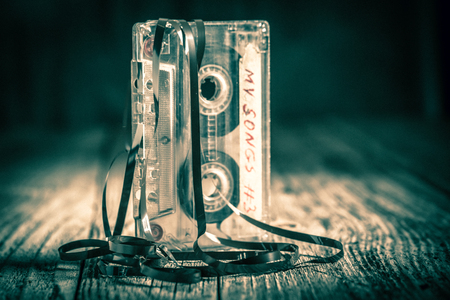 Vintage one audio cassette with an extracted tape
