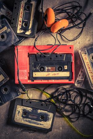 Retro audio cassette with headphones and walkman