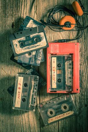 Classic audio cassette with headphones and walkman Imagens