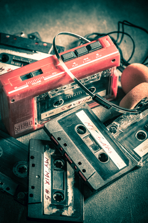 Vintage cassette tape with headphones and walkman 版權商用圖片