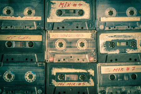 Collection of retro cassette tape on wooden table