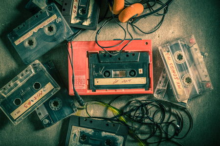 Classic audio cassette with walkman and headphones