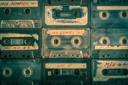 Collection of retro audio tapes on wooden table