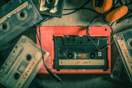 Closeup of cassette tape with walkman and headphones