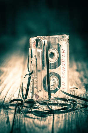 Old one audio cassette with an extracted tape