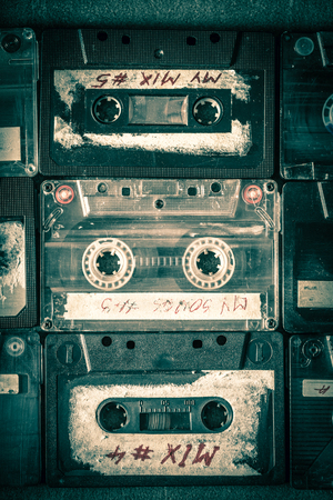 Collection of vintage audio tapes on wooden table