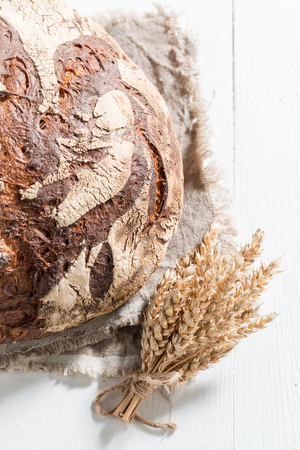 Closeup of tasty bread with several grains on white table Stockfoto