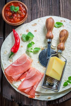 Tasty quesadilla made of tortilla, cheese and ham