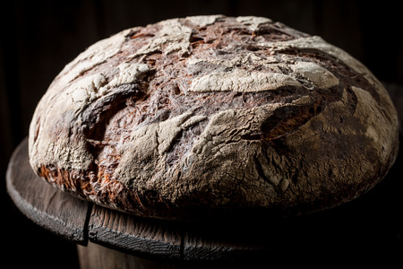 Closeup of healthy bread with whole grains on dark table Stockfoto - 106622574