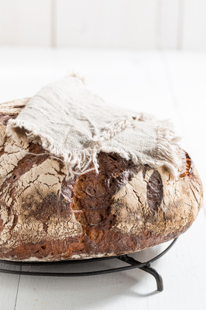 Fresh bread with several grains on linen cloth Stock Photo