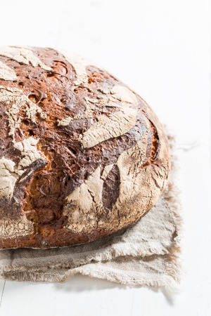 Closeup of loaf of bread for breakfast on white table
