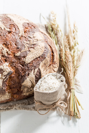 Closeup of loaf of bread with several grains