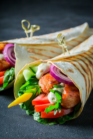 Grilled tortilla with chicken, tomatoes and lettuce