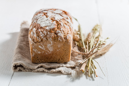 Homemade bread with several grains on linen cloth
