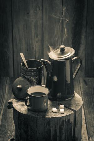 Hot black coffee on wooden vintage stump