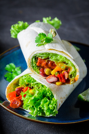 Burrito made of lettuce and vegetables with red salsa 版權商用圖片