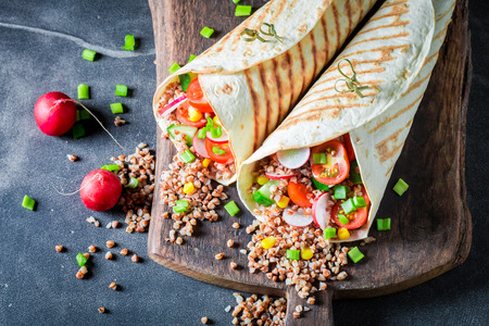 Vegetarian tortilla with chive, cherry tomatoes and groats