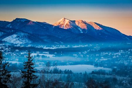 Sunrise in Zakopane with illuminated mountain in winter, Tatra Mountains