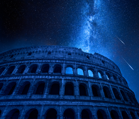 Stunning Colosseum in Rome at night with falling stars, Italy