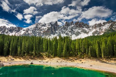 Famous mountain Carezza lake in spring, Alps, Italy